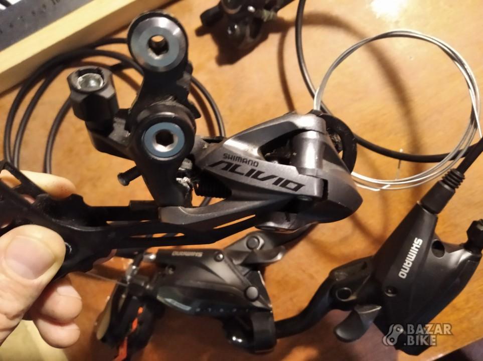 Переключатель задний Shimano Alivio M4000 9ск + комборучки Shimano Acera EF500 + комплект тормозов Shimano MT500
